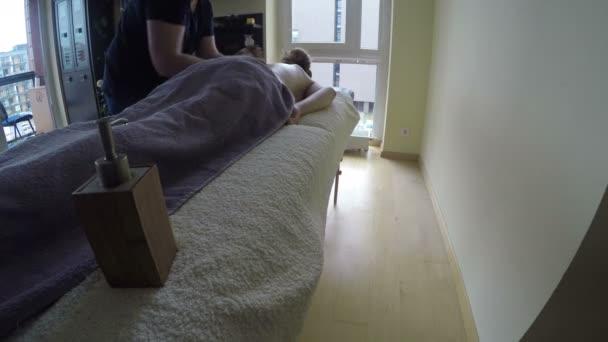 rubber man hands massage client woman girl back. 4K