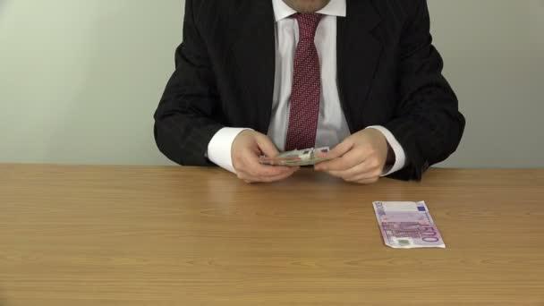 man in suit put different euro cash banknotes on desk. 4K
