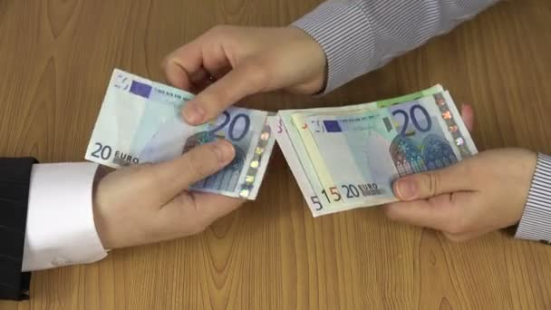 Illegal payment for works. Hand give euro banknotes. 4K