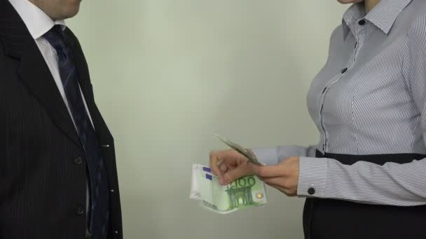 Illegal payment for work. Woman hands pay euro banknotes. 4K
