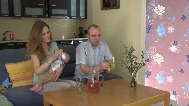 Happy family with baby sleeping prepare Easter decorations. 4K