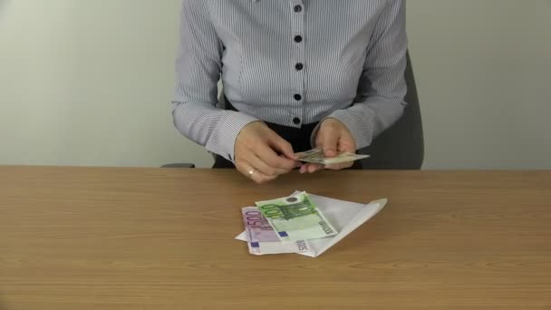 Woman hands count money euro banknotes in envelope. 4K