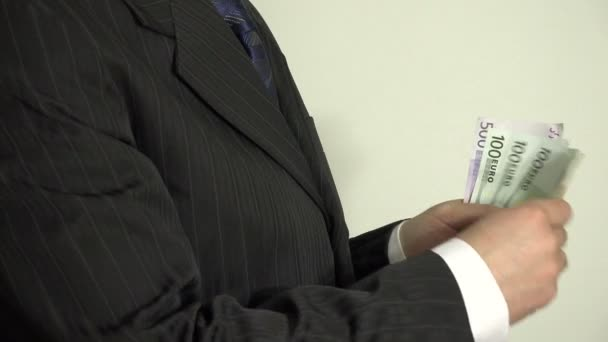 salesman hand count euro banknotes and put in pocket. 4K