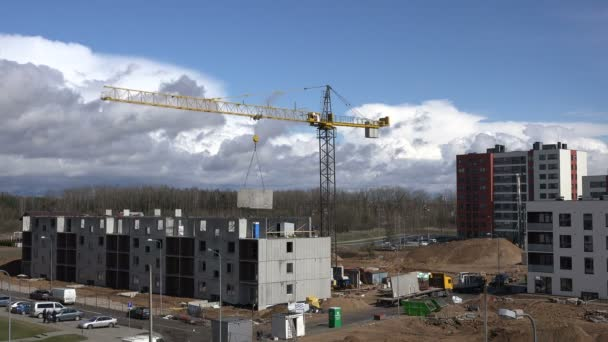 Crane lift block. Flat house apartment construction site works