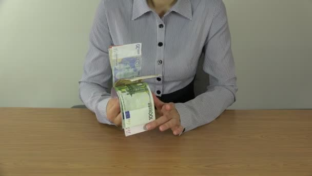 woman in shirt show different euro cash banknotes in hands. 4K