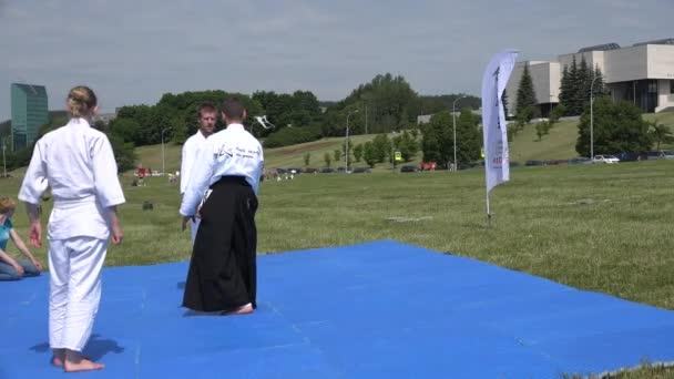 Aikido martial art trainer teaches adults defensive techniques. 4K