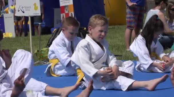 children with karate master man start warming up before workouts. 4K