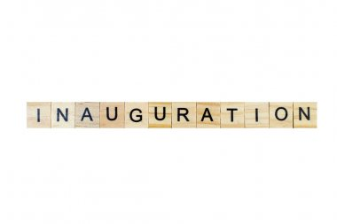 Inauguration . English word on white isolated background composed from letters on wooden cubes. Learning english concept