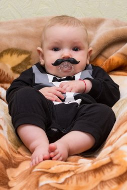 The kid with a dummy mustache