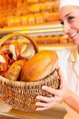 Fényképek Női baker eladási kenyér