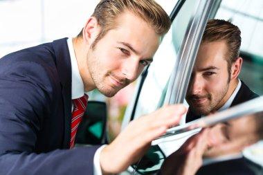 Auto dealer in car dealership