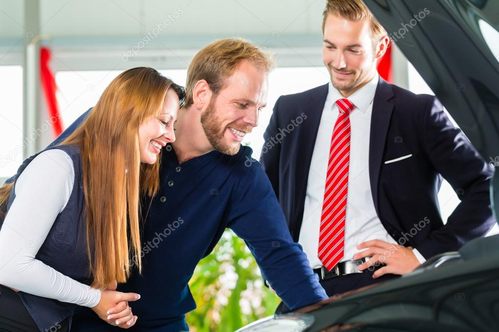 Young Couple and seller with auto