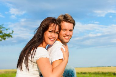 Happy couple on a meadow