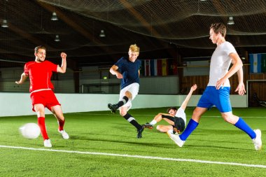 Team playing football or soccer indoor