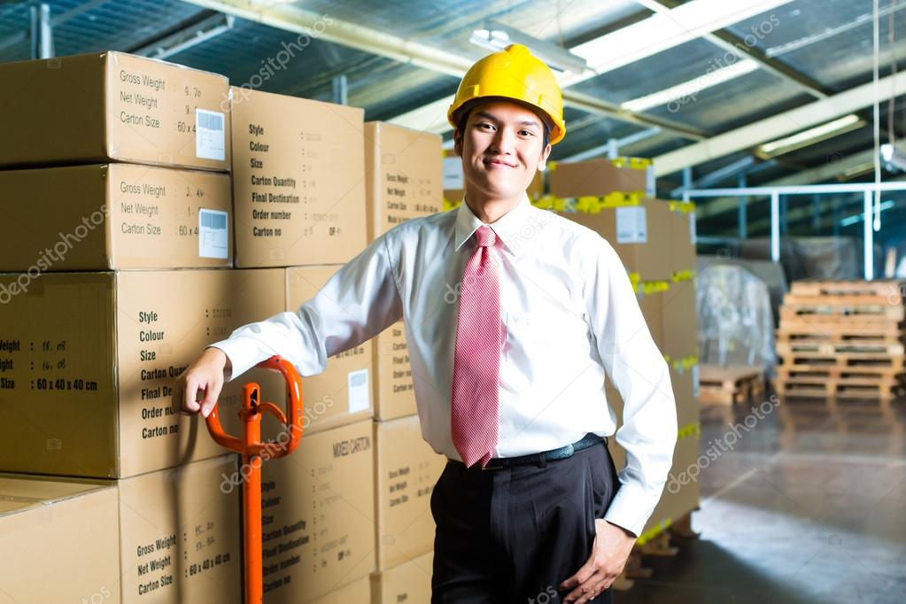 Young Man in warehouse he is a manager