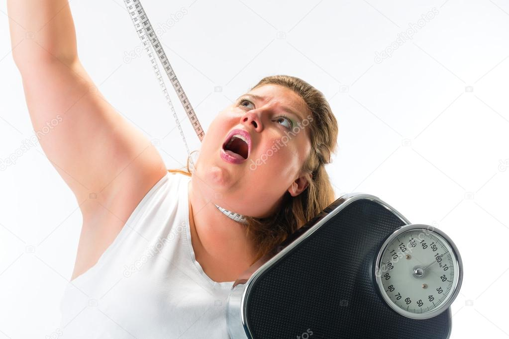 woman strangling herself with measuring tape � stock photo