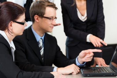 businesspeople have team meeting in an office