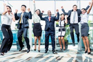 Diversity business team jumping
