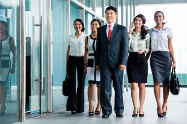 Asian business team marching