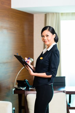 executive housekeeper controlling hotel room