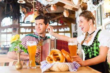 Musician in Bavarian Restaurant playing Accordion