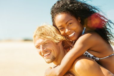 Couple on sunny beach in summer in vacation