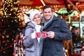 Fotografie Couple drinking spiced wine on Christmas market
