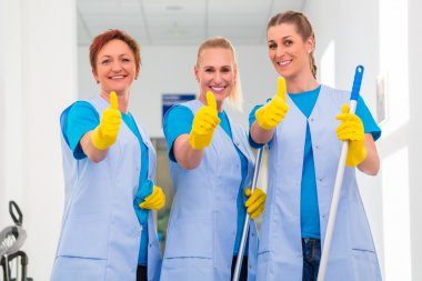 Cleaning ladies working in team