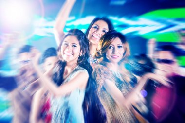 girls partying on dance floor of disco nightclub