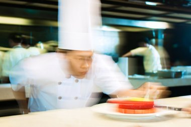 Asian chefs cooking in Restaurant