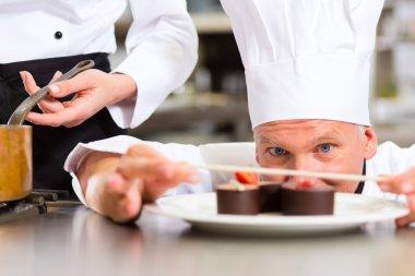 Chef as Patissier cooking in Restaurant dessert