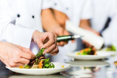 Chef in restaurant kitchen cooking