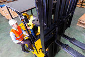 Photo lift truck driver and foreman in storage
