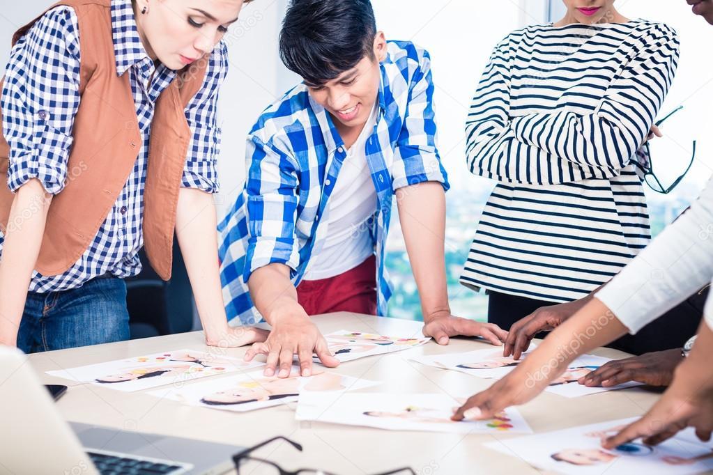 Advertising agency team choosing model for campaign