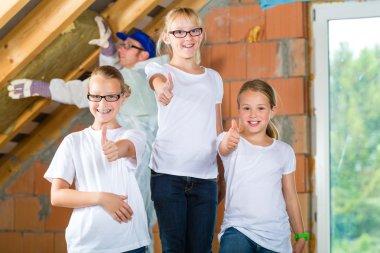 Engineer and daughters building top floor