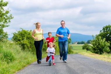 Happy family running for sport on street
