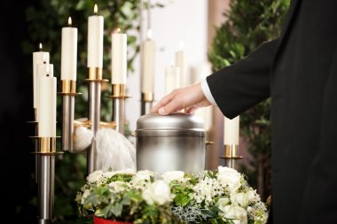 Religion, death and dolor  - funeral and cemetery; urn funeral stock vector