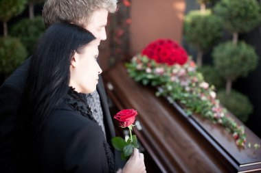 People at Funeral with coffin