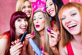 Fotografie Women having bachelorette party with sex toys in night club