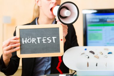 Woman advertising a hearing test