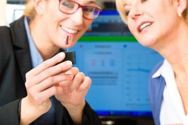 Deaf woman makes a hearing test