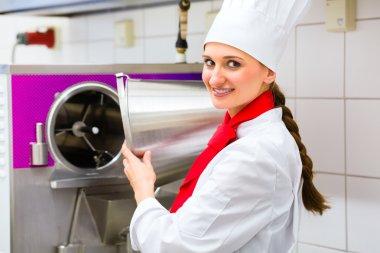 Chef preparing ice cream with machine
