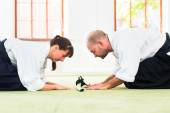 Fotografie Aikido martial arts teacher and student take a bow