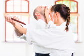 Fotografie Man and woman having Aikido knife fight