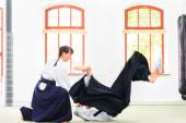 Fotografie Aikido teacher and student training throwing and falling