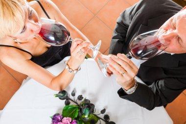 Senior couple eating dinner stock vector