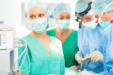 Surgeon doctors  working in operation theater