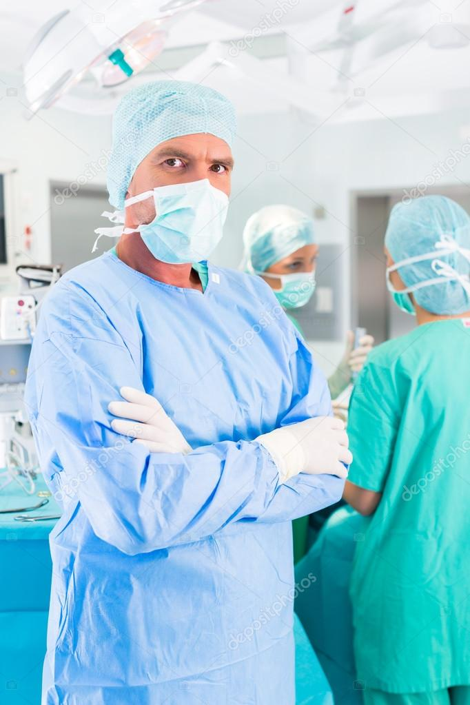 Hospital surgeons operating in operation room