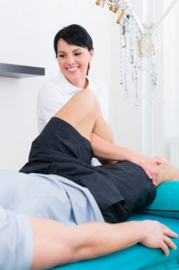 Physiotherapist medicate patient in practice