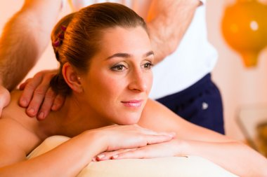 Woman enjoying wellness back massage